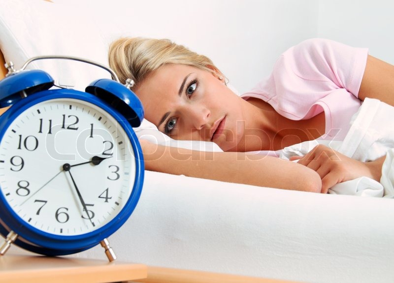 Clock with sleep at night woman can not sleep, stock photo