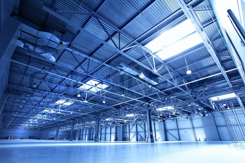 Empty Warehouse Toned In The Blue Color Stock Photo