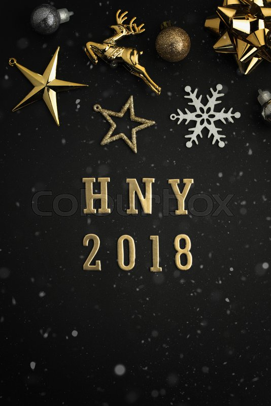 Happy new year 2018 holiday background with gold ornaments and decorations. Merry christmas and happy new year greeting card with copy space. New year celebration holiday background, stock photo