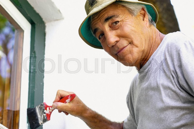 Man painting house | Stock image | Colourbox