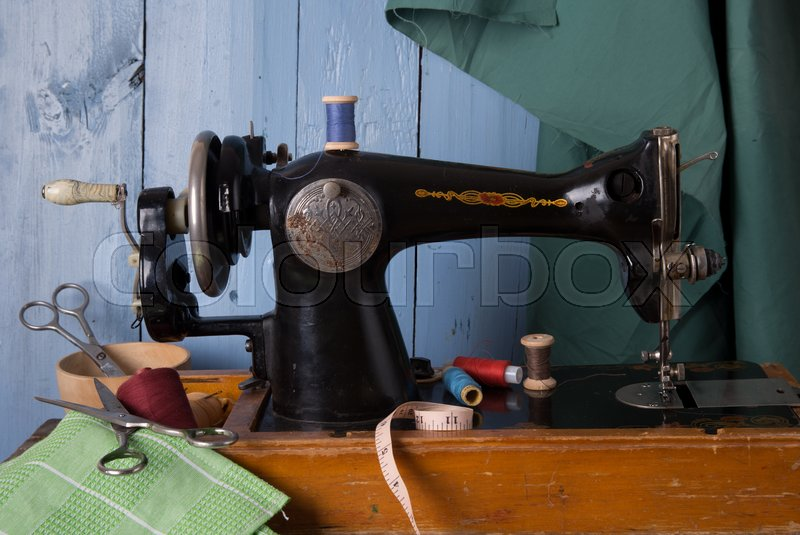 Old Sewing Machine Fabric And Sewing Thread Stock Photo Colourbox Custom Vintage Sewing Machine Fabric