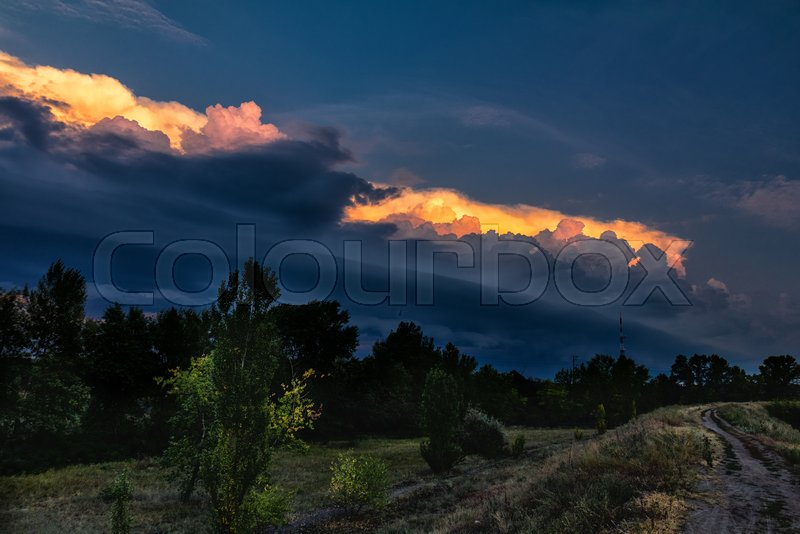 Dark cloud storm. Rain coming on the sky in the rural road view. Beautiful storm sky with dark cloud, stock photo