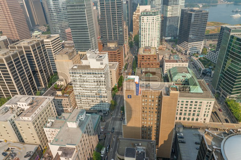 VANCOUVER, CANADA - AUGUST 2017: Aerial view of Vancouver Downtown skyline from city rooftop. Vancouver attracts 15 million people annually, stock photo