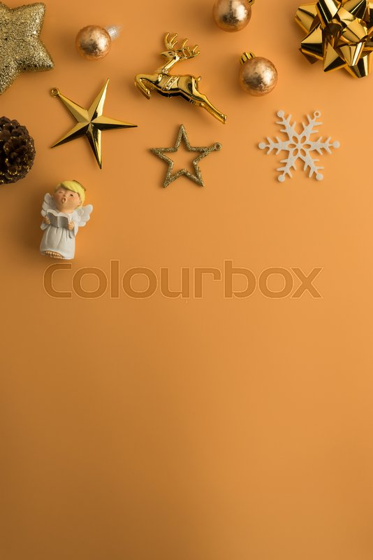 Christmas holiday background with gold ornaments and decorations. Merry christmas and happy new year greeting card with copy space. Christmas celebration holiday background, stock photo