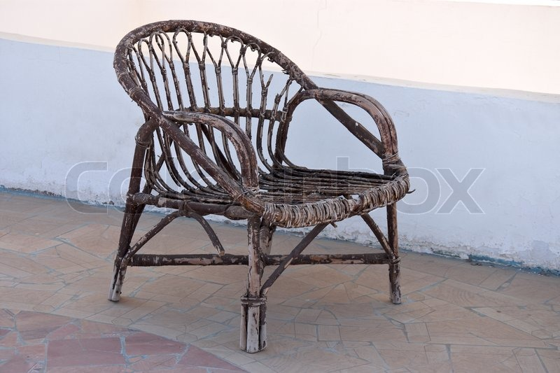 Good Old Wicker Chair Against White Wall Background | Stock Photo | Colourbox