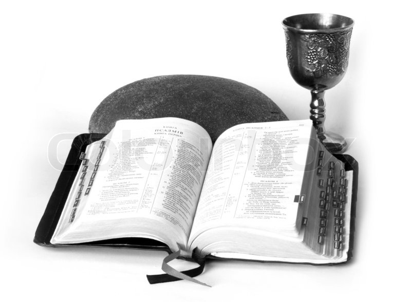 Stock image of 'Open Bible with bread and wine'