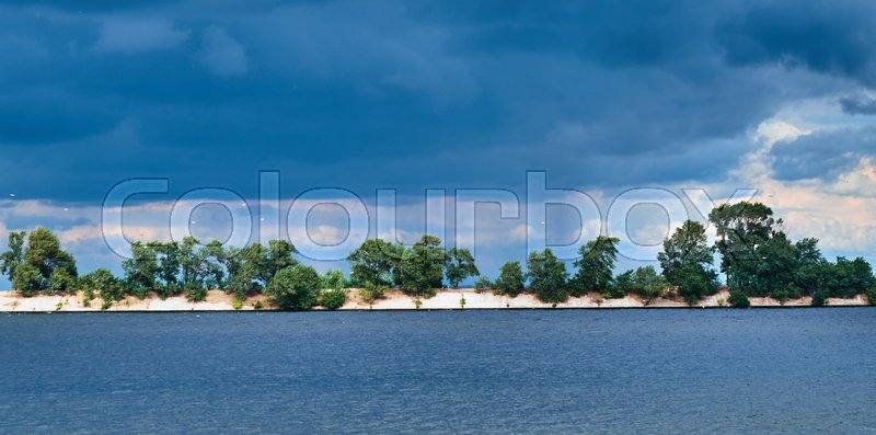 Nature landscape with birds and heavy thunder clouds, stock photo