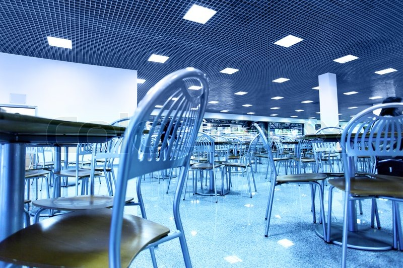 Modern interior of restaurant toned in blue color stock