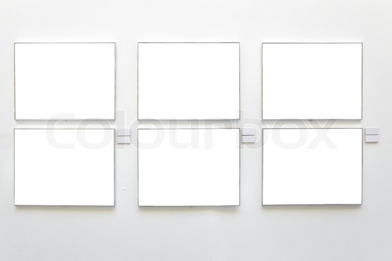 Stock image of blank frames on the wall at art gallery