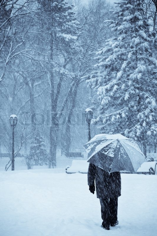 Lonely Old Man With Umbrella Walking Under The Snow
