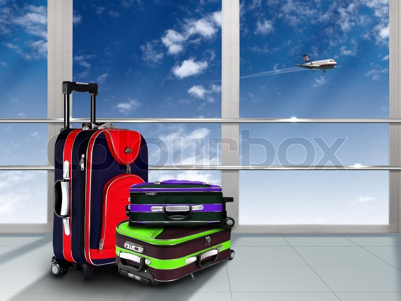 Red suitcase and plane in the blue sky above