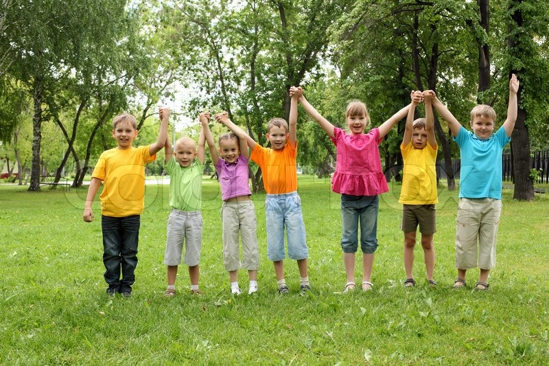 Stock image of 'Group of children having fun together in the park'