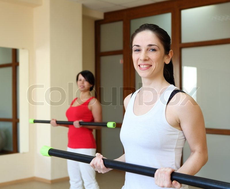 Young woman in sport wear exercising in sport club, stock photo