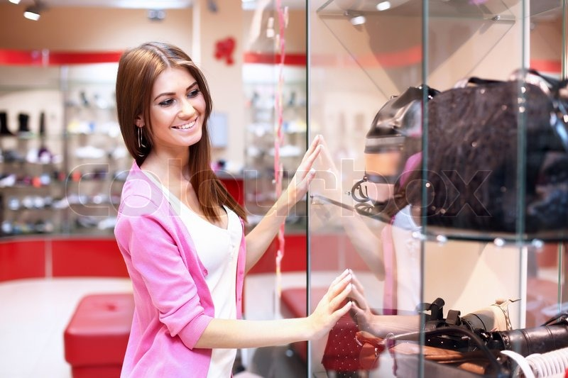 young woman doing shopping in clothes store stock photo. Black Bedroom Furniture Sets. Home Design Ideas