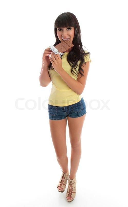 Beautiful Girl Eating Chocolate Stock Photo Colourbox