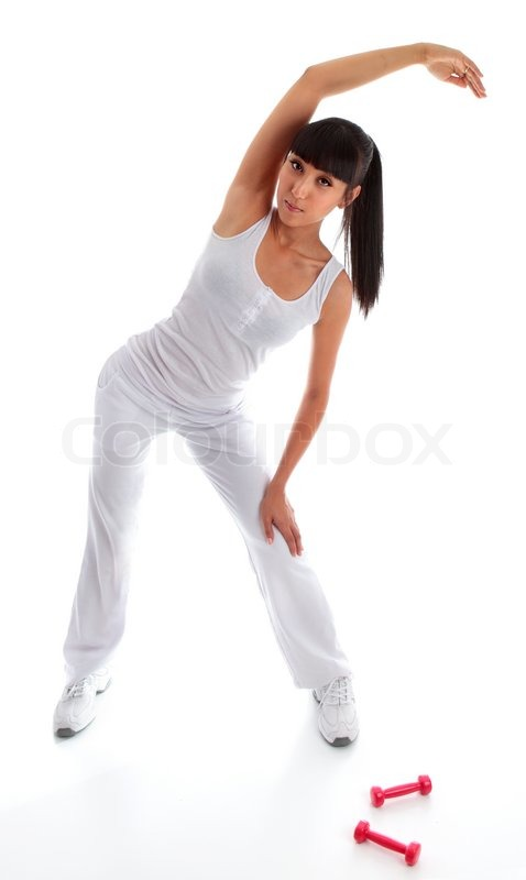 Girl standing and leaning over doing stretching toning ...