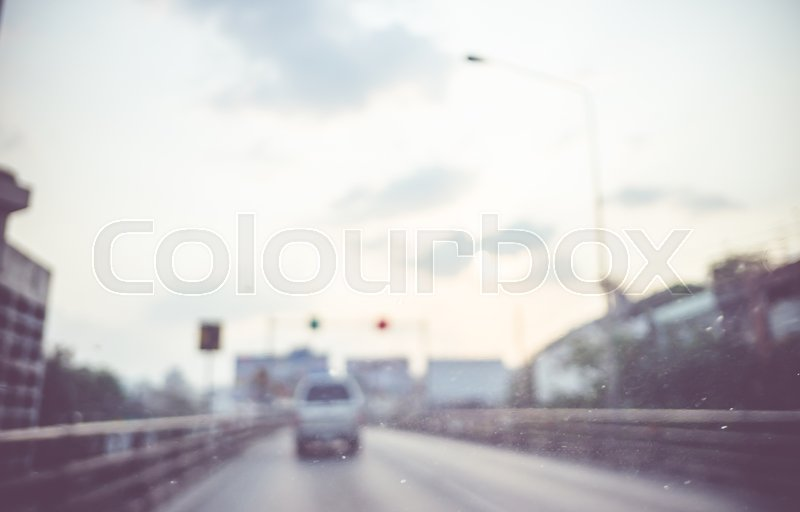 Blur background : see through window of car on high way road in evening with traffic light,Abstract background, stock photo