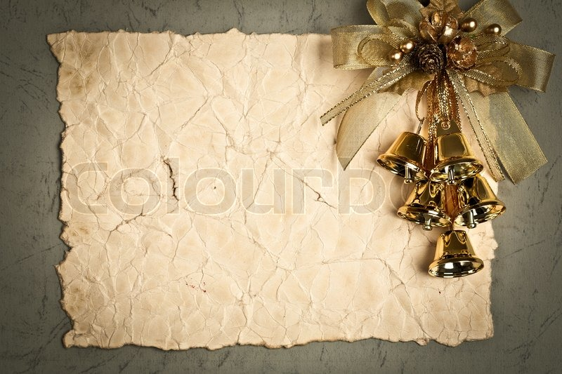 vintage frame with gold decorations on old paper
