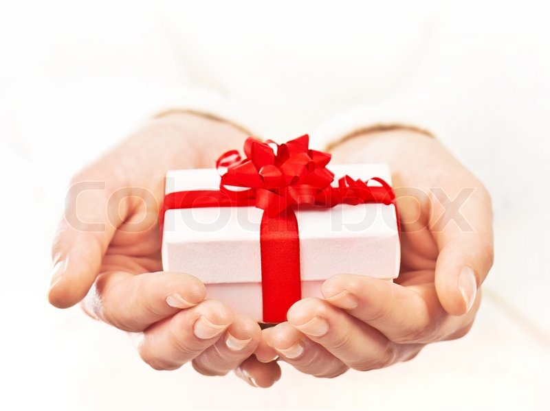 Hands holding beautiful gift box, female giving gift ...