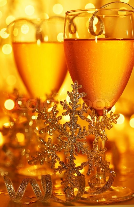 Romantic holiday drink, celebration of Christmas or new year eve, party with Champagne and festive gold ornament lights decoration, stock photo