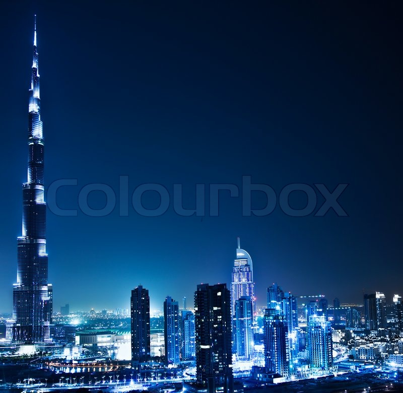 Stock image of 'Dubai downtown night scene with city lights, luxury new high tech town in middle East, United Arab Emirates architecture'