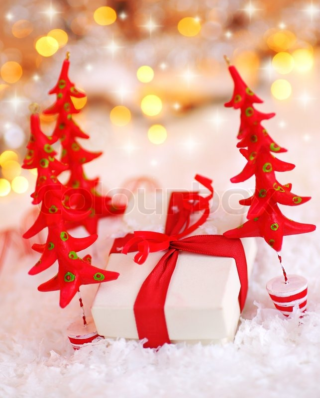 Holiday background with cute snowman christmas tree decorative holiday background with white present gift box wrapped with red ribbon bow christmas tree negle Image collections