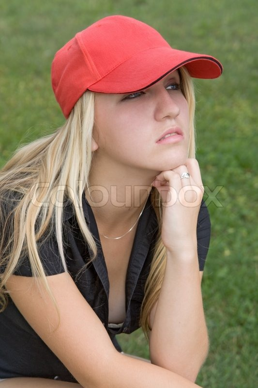 Girl With Red Baseball Cap Stock Photo Colourbox