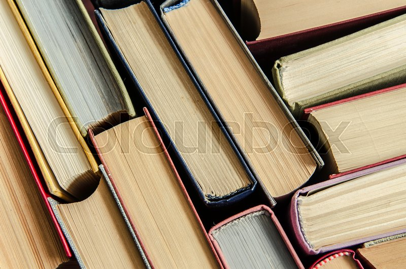 A stack of colorful books in a library or a room   Stock Photo ...