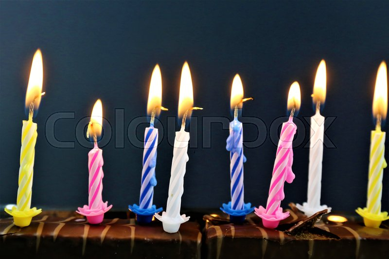 Stock Bild von 'An concept Image of some candles at a children birthday party'