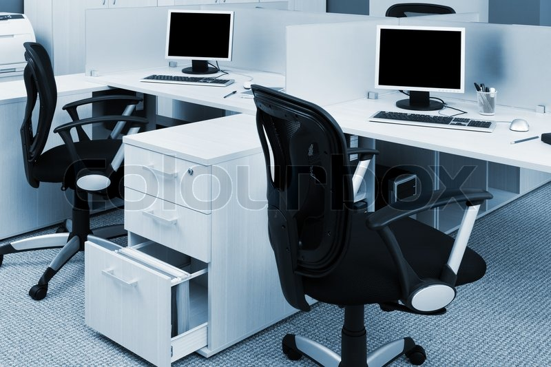 Stock image of 'Printer and computers in a modern office'