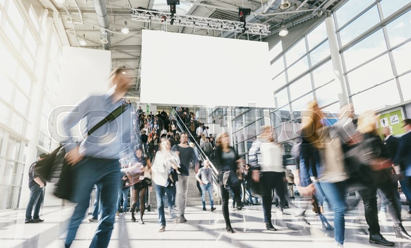 Stock Bild von 'people walking at a trade fair including banner for copy space . ideal for websites and magazines layouts'