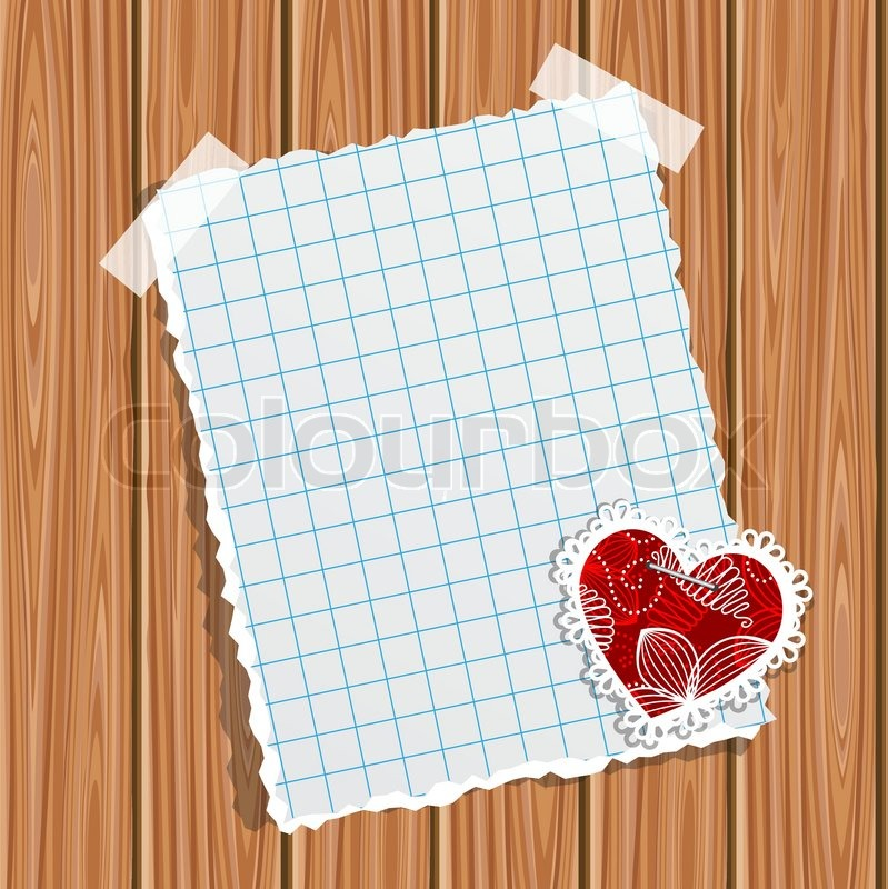blank notebook paper and small valentine on a wooden wall stock