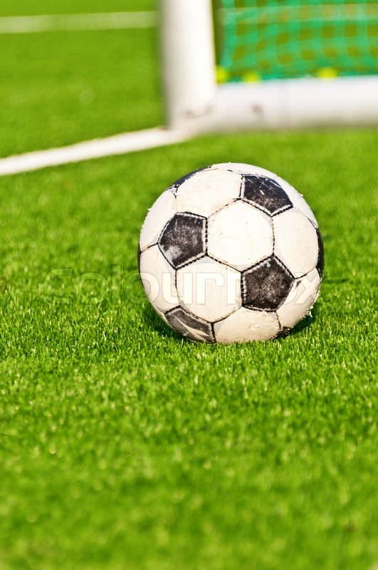 458a62863 Old soccer ball onfootball field with ... | Stock image | Colourbox