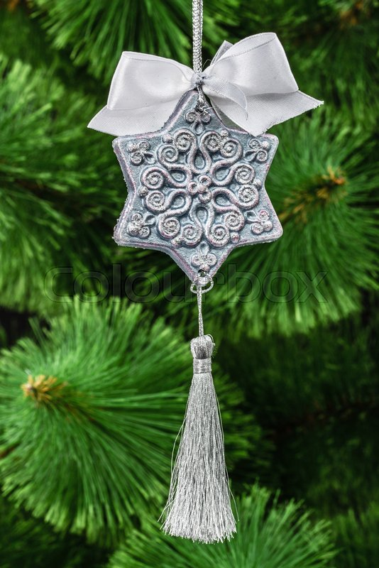 Beautiful toy of hand-worked for festive decoration, on a Christmas tree background, stock photo