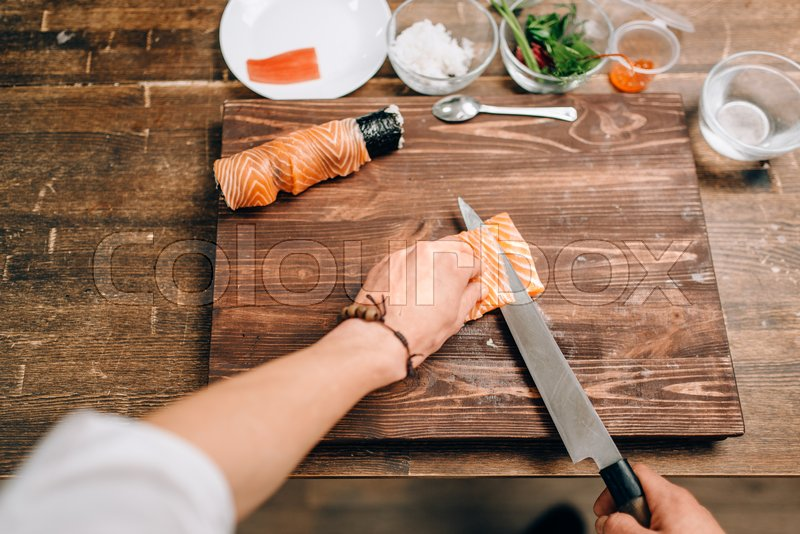 Male person cooking seafood on wooden table, asian kitchen ...