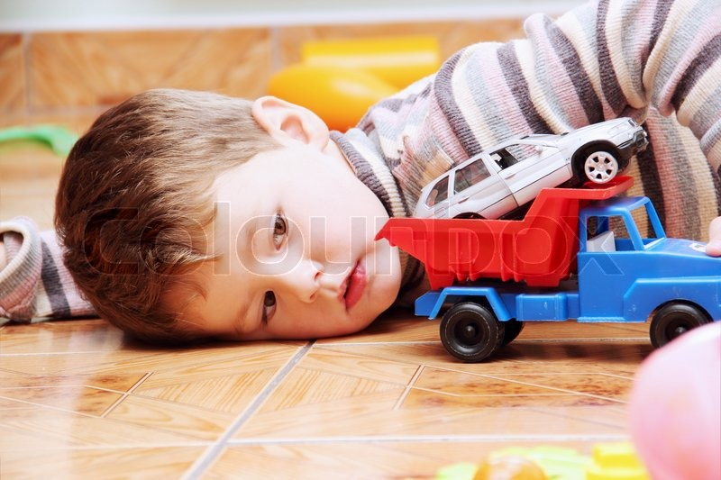 Little Boy With Toy Car : Little boy playing with toy car truck close stock photo
