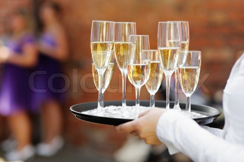 Waiter Serving Champagne At Festive Event Stock Photo