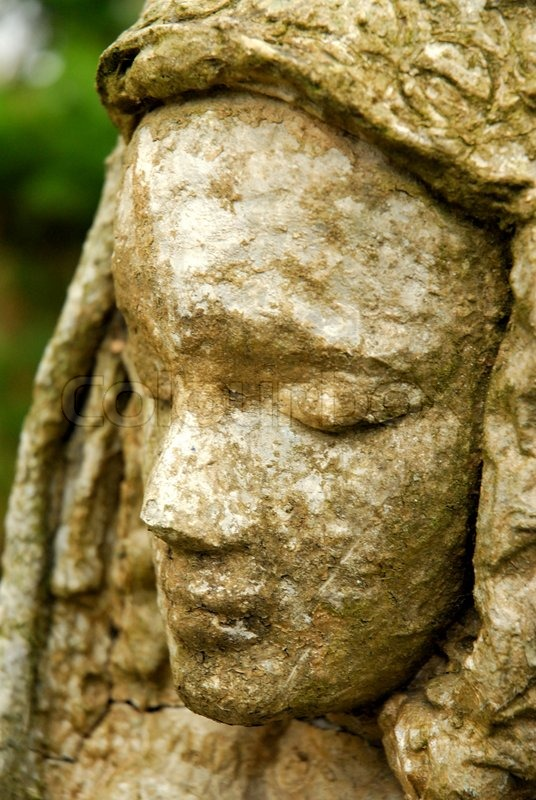 Weathered Statue Of A Desperate Woman