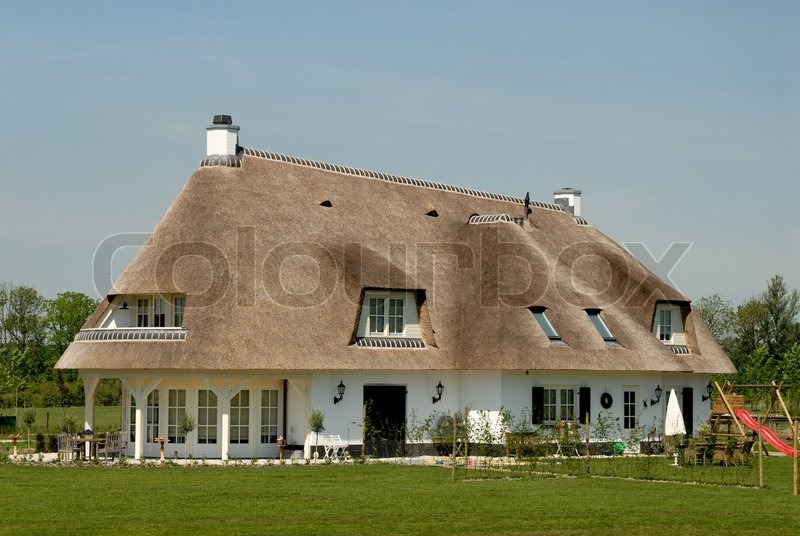 Traditional Cottage With Thatched Roof In The Netherlands