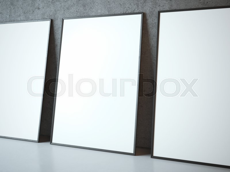Three blank white frames near concrete wall | Stock Photo | Colourbox