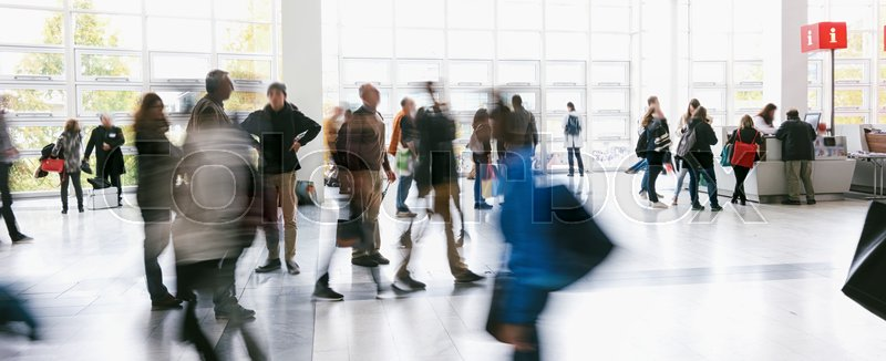 Abstract blurred business people rushing on a airport. ideal for websites and magazines layouts, stock photo