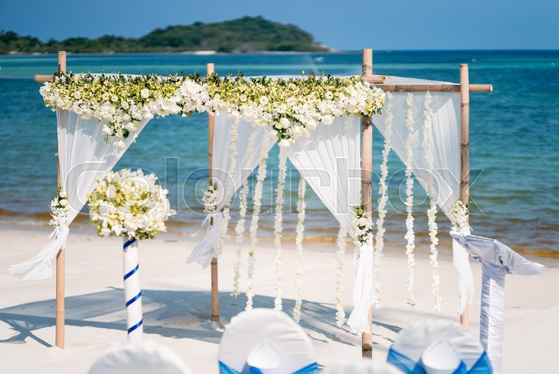 Floral wedding arch decoration beach wedding decoration with the floral wedding arch decoration beach wedding decoration with the blue sea in the background sareeraya resort spa in samui island thailand junglespirit