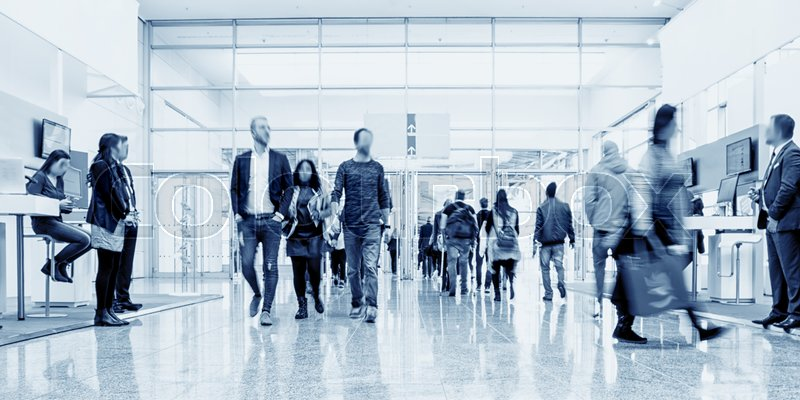 Crowd of business people walking in a modern hall at a trade show. ideal for websites and magazines layouts, stock photo
