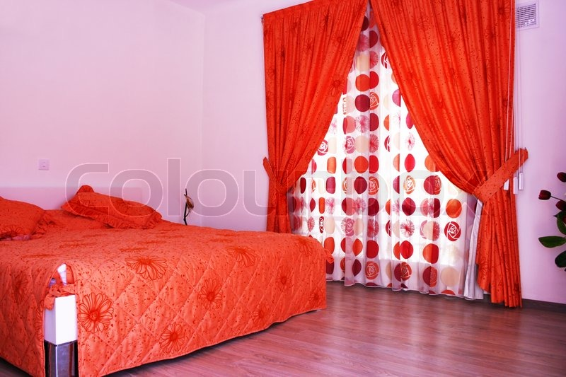Bedroom with pink walls, red curtains ... | Stock image ...