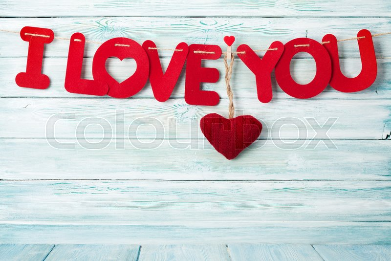 Valentines day greeting card with i love you words over wooden valentines day greeting card with i love you words over wooden background with space for your greetings stock photo colourbox m4hsunfo