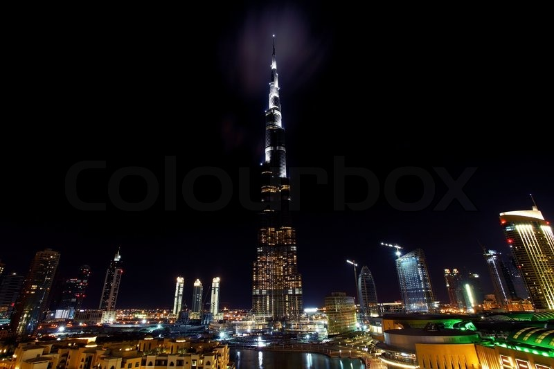 Stock image of 'Dubai downtown night scene with city lights'