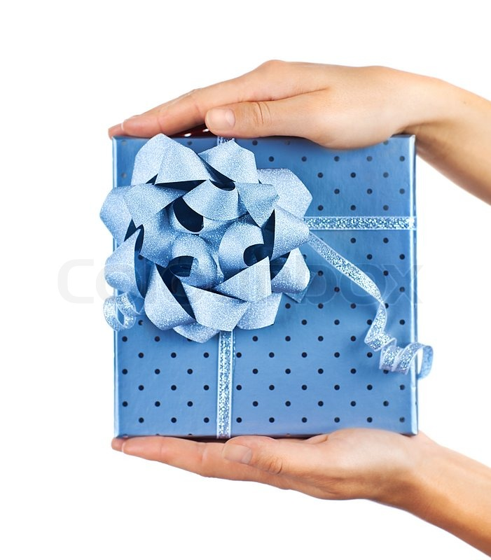 Stock image of 'Woman hands holding beautiful blue gift box, giving gift concept, christmas holidays and greeting season, isolated on white background'