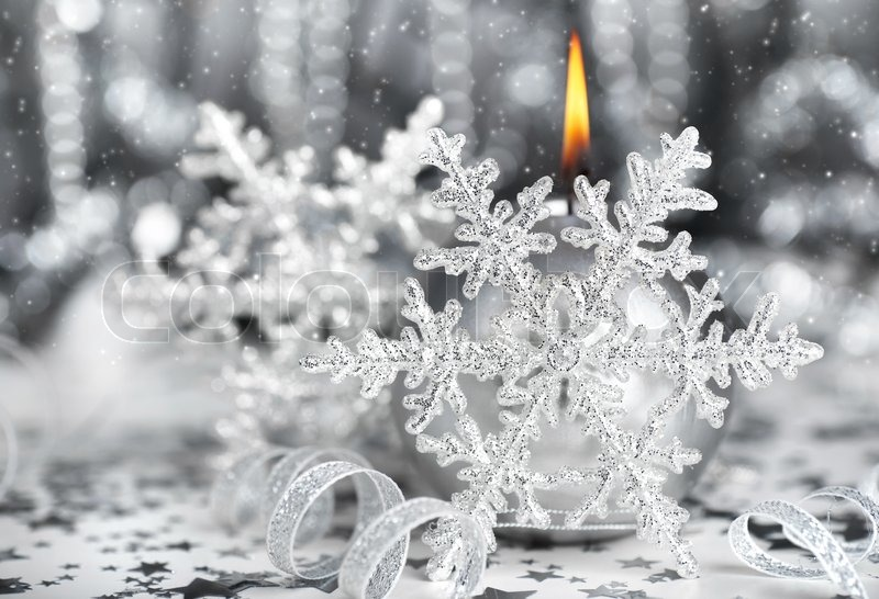 Christmas decoration silver holiday background with candle