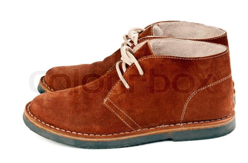 3a1c9877cbee A pair of brown suede shoes isolated on ...
