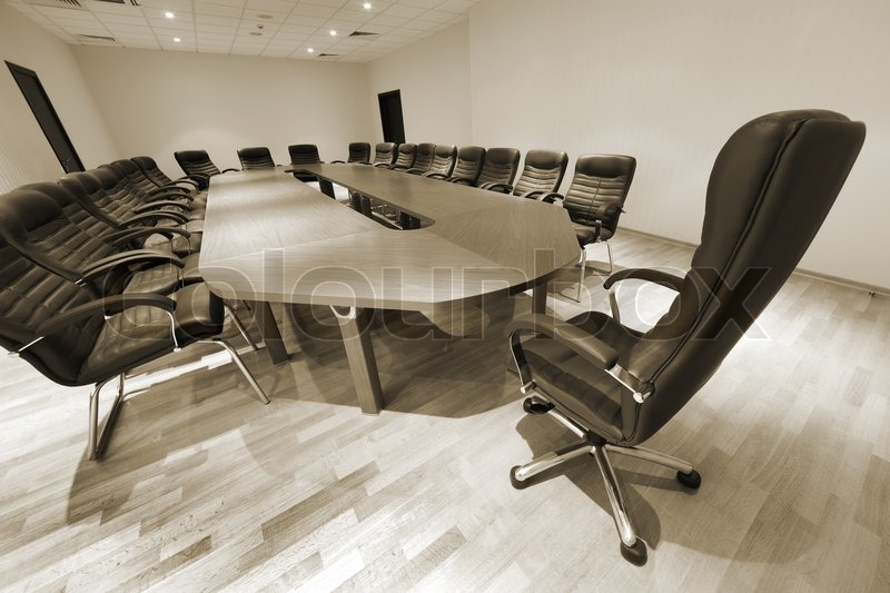 A Large Table And Chairs In A Modern Conference Room Stock Photo - Large white conference table